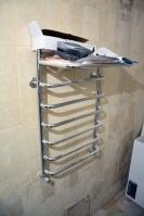 Ремонт ванной комнаты подизайн-проекту: установленный полотенцесушитель